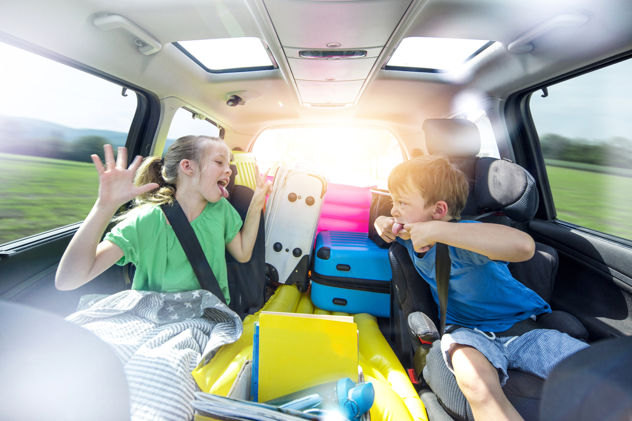 Holidays - Siblings arguing in the car during a long car journey
