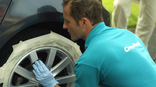 someone repairing an alloy wheel