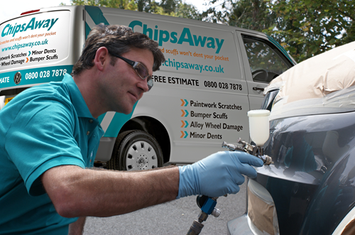 chipsaway repair specialist respraying a car bumper for professional repair