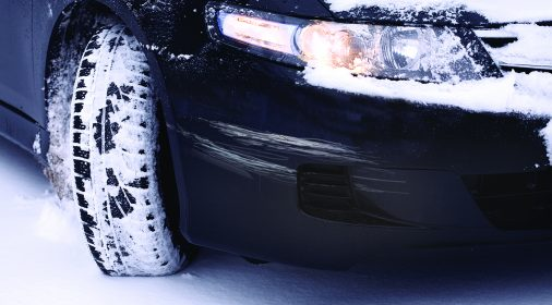 car scratch on a car front, car has snow on it