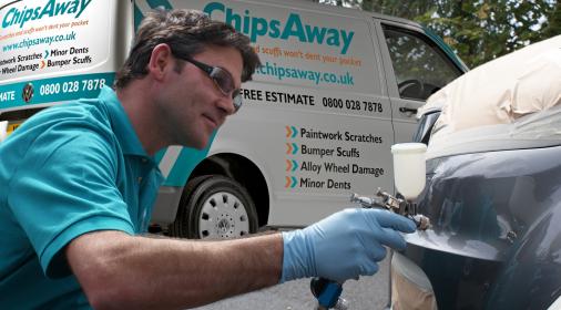 chipsaway specialist repairing a bumper