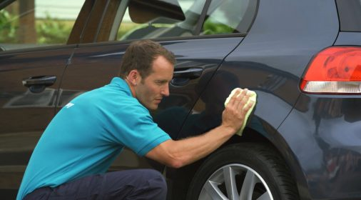 a chipsaway specialist doing finishing touches on a car