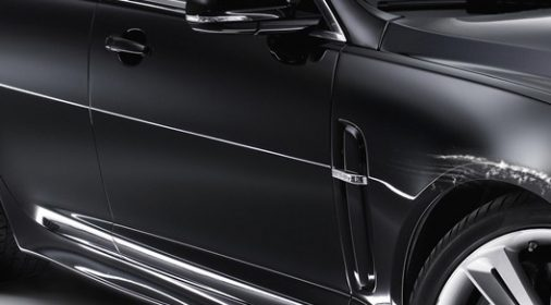 a scratch in the paint work on a black car