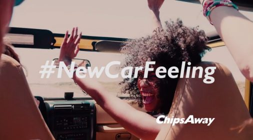 woman in the front of a car with her hands up in the air