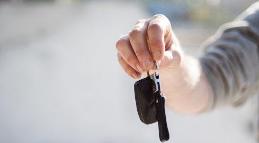 someone holding keys, background blurred