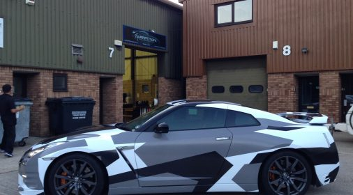 grey, black and white wrap on car