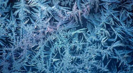 background made of winter frozen window glass