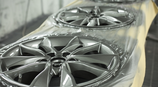 alloy wheels lined up to be repaired and refurbished painted silver