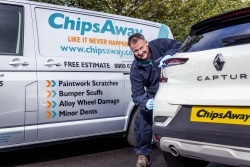 Mobile ChipsAway specialist looking at damage on customer car